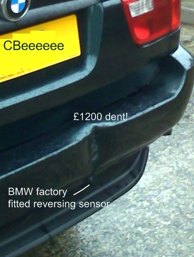 Dent on BMW due to not having a reversing camera